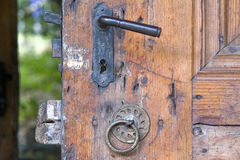 Old fashioned knocker on the wooden door Royalty Free Stock Photography