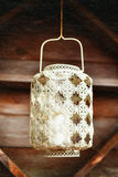 Old-fashioned lacy white lantern. Textured background. Stock Image