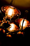 Old-fashioned lamp. Elegant old-fashioned lamp on black background Royalty Free Stock Photos