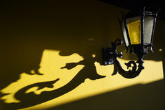 Old Fashioned Lamp Yellow Wall Royalty Free Stock Photography