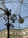 Old-fashioned lamppost and skylight.  stock photos