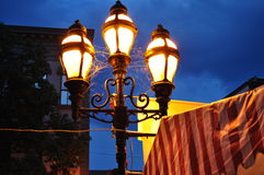 Old Fashioned lamps against dark sky backdrop Stock Photos