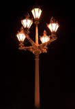 Old-fashioned lantern. With five lamps at night Stock Image