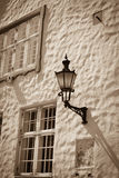 Old-fashioned lantern. On the wall - sepia toned Stock Images