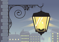 Old-fashioned lantern silhouette and night town pa Stock Photography