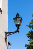 Old-fashioned lantern. On the wall Stock Photo