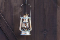Old fashioned lantern on an wooden wall Royalty Free Stock Photos