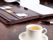 Old fashioned leather folder with coffee Royalty Free Stock Photos