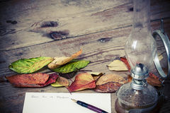 Old fashioned letter. With a lamp and leafs Royalty Free Stock Photo