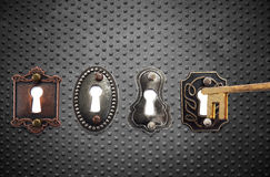 Old fashioned locks and gold key Stock Image