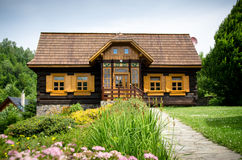 Old fashioned log wooden cottage Royalty Free Stock Photo