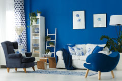 Old-fashioned lounge. Old-fashioned cozy lounge in blue and white colors Royalty Free Stock Photography