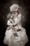 Old Fashioned Love. Mother and Son, dressed in vintage Cival War/Victorian era attire, looking at one another royalty free stock photos