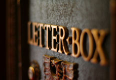 Old fashioned mail box. Old mail box with gold letters and eagle. Shallow DOF Stock Photography