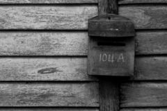 Old-fashioned mailboxes on wooden wall stock images
