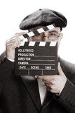 Old fashioned man and movie clapper Royalty Free Stock Photo