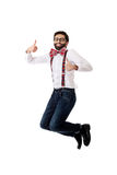 Old fashioned man wearing suspenders jumping. Stock Photo
