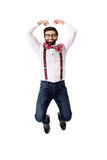 Old fashioned man wearing suspenders jumping. Royalty Free Stock Image