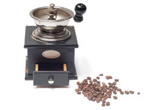 Old-fashioned manual burr-mill coffee grinder. On white royalty free stock photos