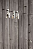 Old-fashioned metal clothespins hanging on the clothesline rope Royalty Free Stock Image