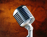 Old Fashioned Microphone. Antique microphone on a wood background Royalty Free Stock Photos