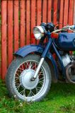 Old fashioned motorcycle. Old fashioned russian motorcycle in the countryside Stock Image