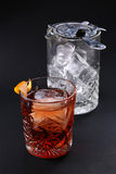 Old fashioned Negroni cocktail near glass with ice on the black background Royalty Free Stock Photography