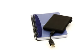 Old fashioned notebook and an external hard drive, Stock Image
