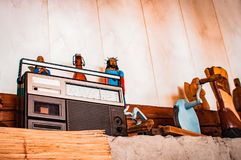 Old fashioned object like an old radio, statues and a bottle of lemonade royalty free stock photo