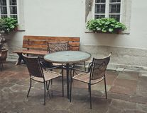 Old fashioned outdoor cafe in rainy day. Rainy morning in the city. Empty street cafe. Romantic walk through the ancient city of Lviv, Ukraine Royalty Free Stock Photography