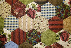 Old-fashioned patchwork quilt stock image