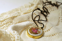 Old Fashioned Pendant On Lace Royalty Free Stock Photography