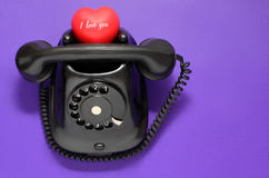 Old-fashioned phone with heart Stock Image