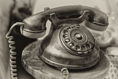 Old-fashioned phone. Isolated on a blurred background Stock Image