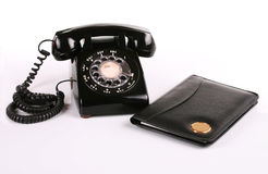 Old fashioned phone and notepad Royalty Free Stock Photos
