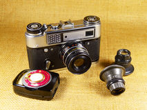 Old-fashioned photo-camera and accessories Royalty Free Stock Photo