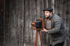 Old fashioned photographer works with large format camera. Concept - photography of the 1930s-1950s royalty free stock photo