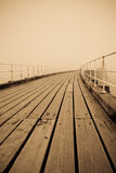 Old fashioned Pier. Whitby West Pier and Harbour in thick fog. Yorkshire, England stock photography