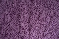 Old fashioned pink knitted lace. From above royalty free stock photos