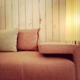 Old fashioned pink sofa and lamp Stock Photos