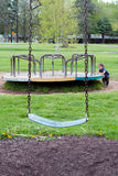 Old fashioned play ground equipment and little boy Royalty Free Stock Photography
