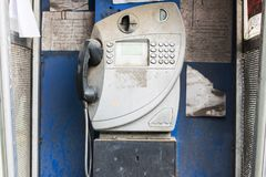 Old fashioned public pay phone in telephone box Stock Photos
