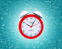Old fashioned red alarm clock. On abstract blue background Royalty Free Stock Images