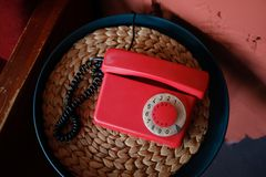 Old-fashioned red phone in beautiful retro interior royalty free stock photography