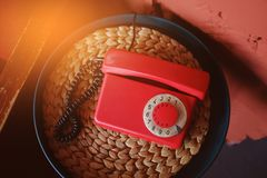 Old-fashioned red phone in beautiful retro interior, toned.  stock images