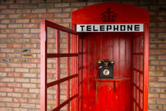 Old Fashioned Red Telephone Booth with Open Door Royalty Free Stock Images