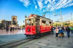 Old-fashioned red tram at Taksim square - the most popular destination in Istanbul. ISTANBUL, TURKEY: Old-fashioned red tram at Taksim square - the most popular stock images