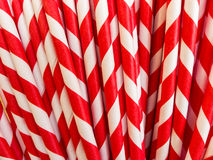 Closeup of red and white striped paper straws Royalty Free Stock Images