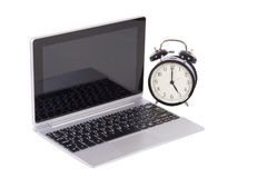 Old fashioned retro alarm clock and laptop Royalty Free Stock Images
