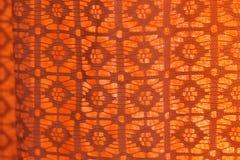 Old-fashioned retro curtain. Old fashioned retro orange curtain Stock Image